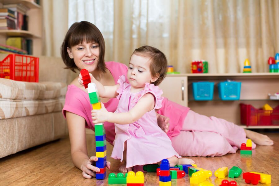 Caregiver and child playing with blocks