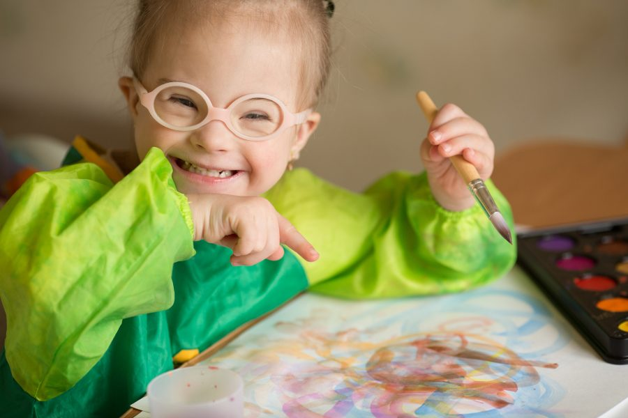 Girl smiling with her painting